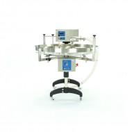 Пристрій для дозування, кремування і накачування меду з столом обертовим